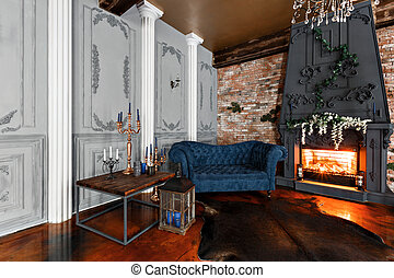 Interior with fireplace, candles, skin of cows, brick wall, large window and a metal cell of a loft, living room, coffee table and dark blue sofa in modern design