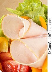Close-up of an healthy mixed salad with roast turkey,...
