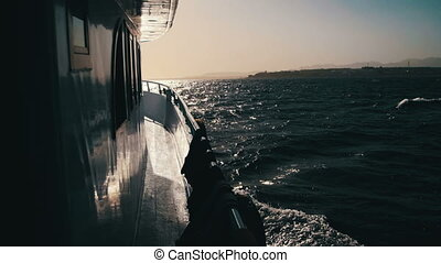 Pleasure Boat Floating on the Red Sea at Sunset Against....