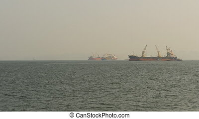 Cargo ships float in the sea. Asia. Vietnam.