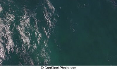 Flying over ocean with big foamy waves - Aerial seascape....