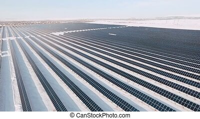 Aerial view large industrial Solar Energy Farm. - Solar...