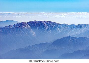 Fog between the rocks in Huangshan National park. Park...