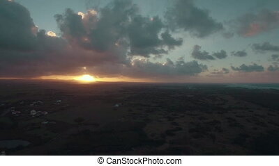 Scenic aerial view of sunset in Mauritius - Flying over the...
