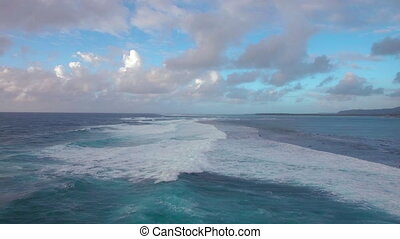 Seascape with foamy waves of blue Indian Ocean, aerial view...