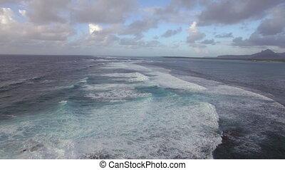 Foamy waves of Indian Ocean, aerial view - Flying over dark...