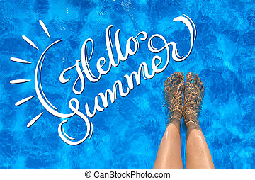 Female legs in the pool water and text Hello summer....