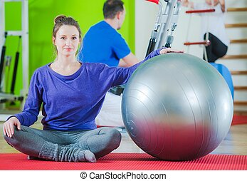 Exercise Ball Exercises For a Fit Body. Caucasian Woman in...
