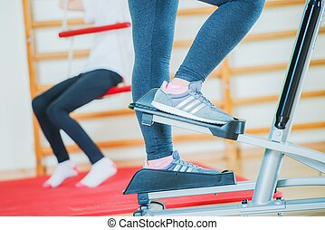 Stepper Workout Closeup. Woman on the Stepper in the Fitness...