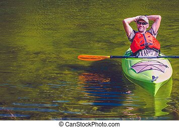 Relaxed Kayaker on the Lake. Caucasian Sportsman. Water...