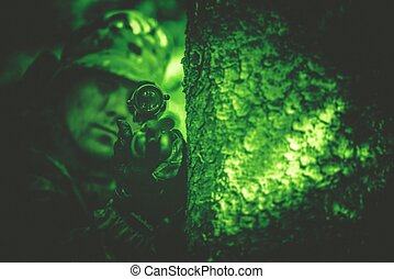 Poacher in Night Vision - Hunting Poacher with Riffle in...