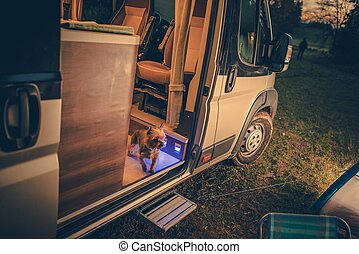 Dog in the Camper Van. Rving with Pets Concept Photo....