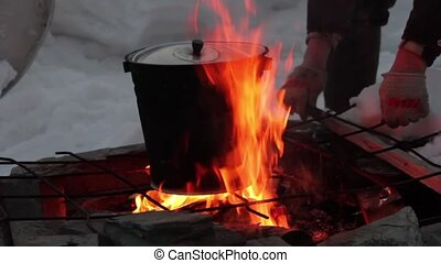 cooking on the fire. pan over an open flame - Real flames in...