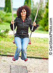 Young woman outdoor in a swing