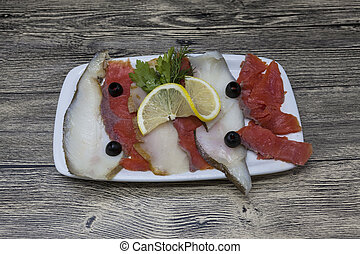 Smoked fish delicacies from the Northern seas halibut,...
