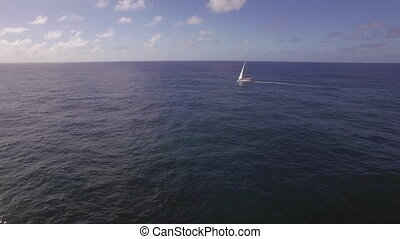 Yacht sailing in the ocean, aerial view - Flying over...