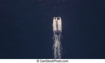 Flying over white yacht sailing in blue ocean - Aerial top...