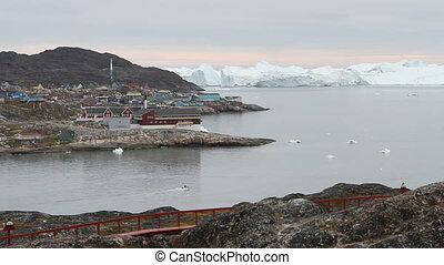 Boats leaving Ilulissat - Two small boats leaving the...