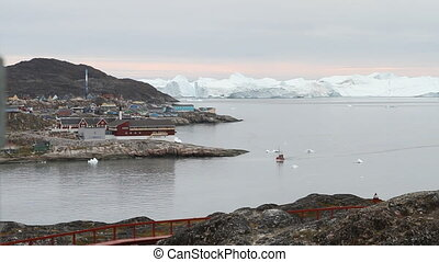 Fishing boat coming back to the harbour in Ilulissat,...