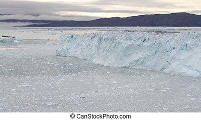 The Eqi glacier calving - A piece of the Eqi glacier in...