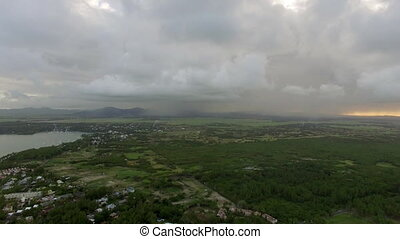 Flying over Mauritius Island with low clouds - Aerial shot...