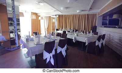 decorated hall for a wedding banquet in a restaurant.