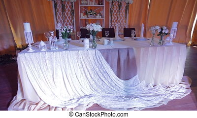 Groom and bride table served for a wedding dinner.