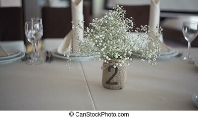 beautiful wedding decoration on a table in a restaurant