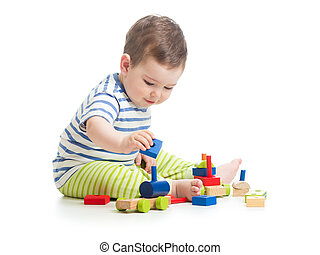 Baby boy playing with blocks toys isolated on white