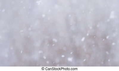 Slow motion background of snow fall blowing fast in winter daytime