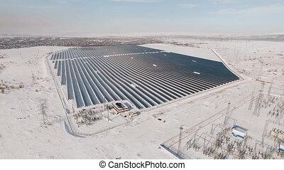 aerial solar farm winter flight