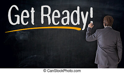 Businessman writes get ready on blackboard concept.