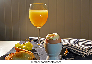 boiled eggs and orange juice for breakfast