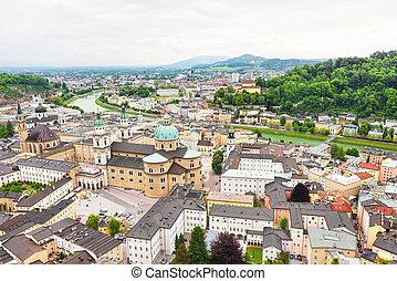 Panoramic view over stadt salzburg with salzach river, rainy...