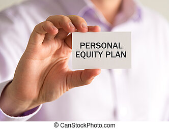 Businessman holding a card with PERSONAL EQUITY PLAN message...
