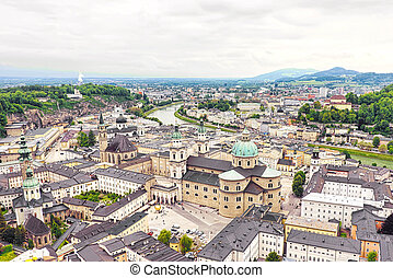 Panoramic view over stadt salzburg with salzach river, rainy...