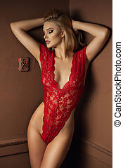 Young sexy woman wear red lingerie in brown room