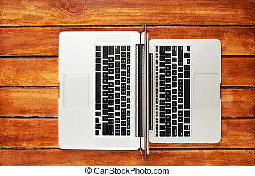 two laptops view above - Keyboards of two laptops view from...