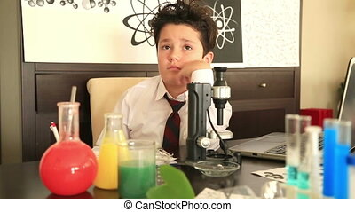 Elementary school boy studying chemistry - Student doing...