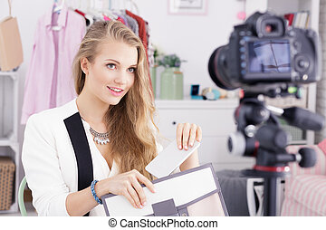 Blogger and shopping video - Young beautiful female blogger...