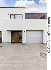 Minimalistic modern housefront with cobbled pathway