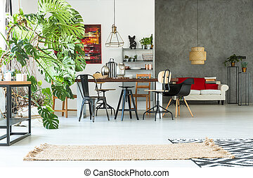 Functional apartment with dining table, sofa, chair and...