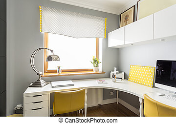 Large, angular desk in an office - Large, angular desk and...
