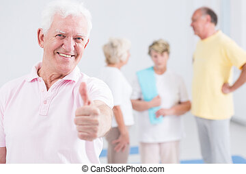 Man showing his thumb up - Elderly man showing his thumb up...