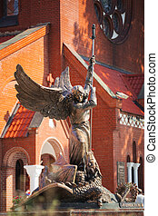 Statue Of Archangel Michael near Red Catholic Church Of St. Simon