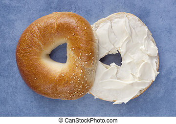 Bagel with Cream Cheese - Cut bagel spread with cream...
