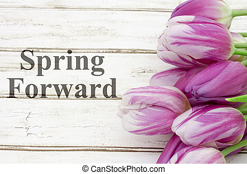 Spring Forward message, A bouquet of purple tulips on...