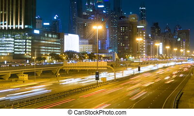 beautiful night timelapse of a road in Dubai, UAE - On the...