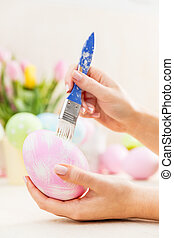 Easter egg decorating in an atelier. Artistic handicraft....