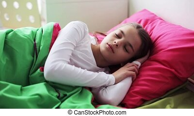 girl sleeping in her bed at home - children, rest and people...